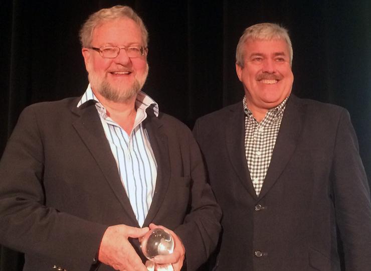 Ian Atkins presents YachtWorld Hero award to David Rockefeller, Jr.