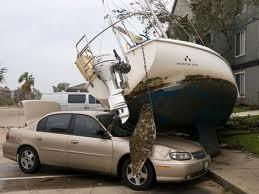 boat sitting on top of a car after storm