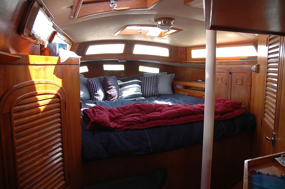 The Cheoy Lee 44 has an expansive master stateroom with plenty of light and tons of stowage space.