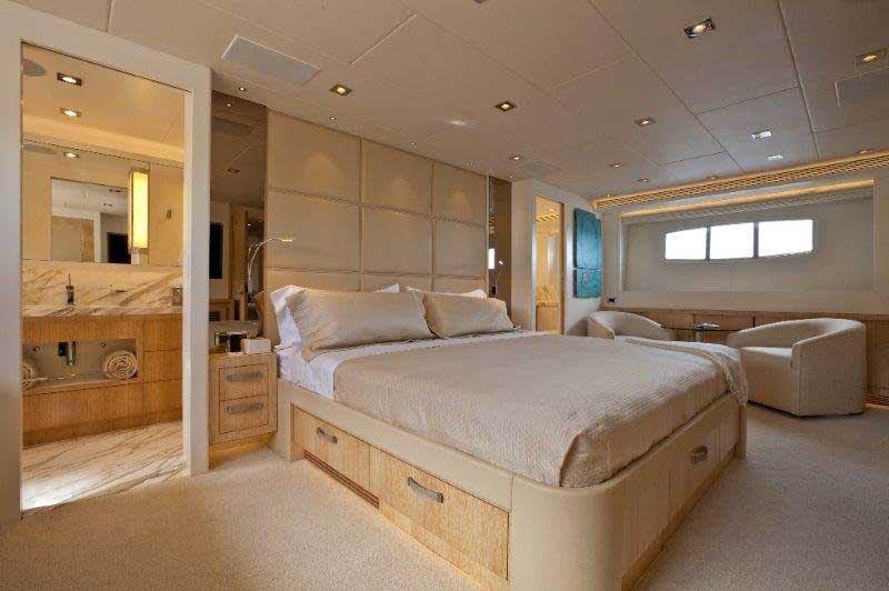 Because of the galley configuration, the master stateroom aboard Andrea IV is below decks. It's still full beam, and it's nicely accentuated with a leather headboard and satin-finished white oak. If you get up close to the headboard, you'll notice grey-tone stitching. The contrast is simple, yet sophisticated.