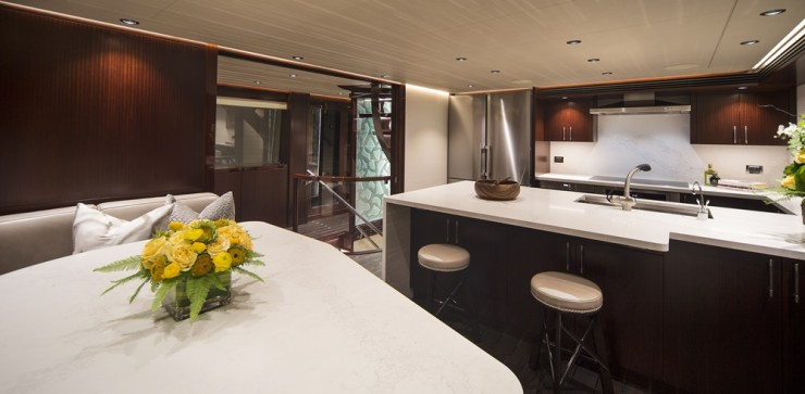 Speaking of space, even with a formal dining area, the galley aboard Black Gold is significant in size. It's large enough to contain a country kitchen, along with a barstool-lined prep island.