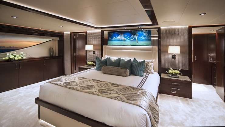 Main-deck master suites are coveted. The stateroom spans the beam aboard the 125, as you'd expect. The standard wood offering is mahogany, with pomelle sapele accents. Again, clients can choose what they wish.