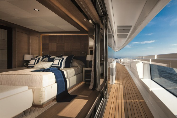 Guests may be hard pressed to leave, too, with accommodations like this. This VIP suite on the main deck doesn't just have sliders out to the side deck. Note the glass inset into the bulwark. That guarantees better views even while lying in bed.