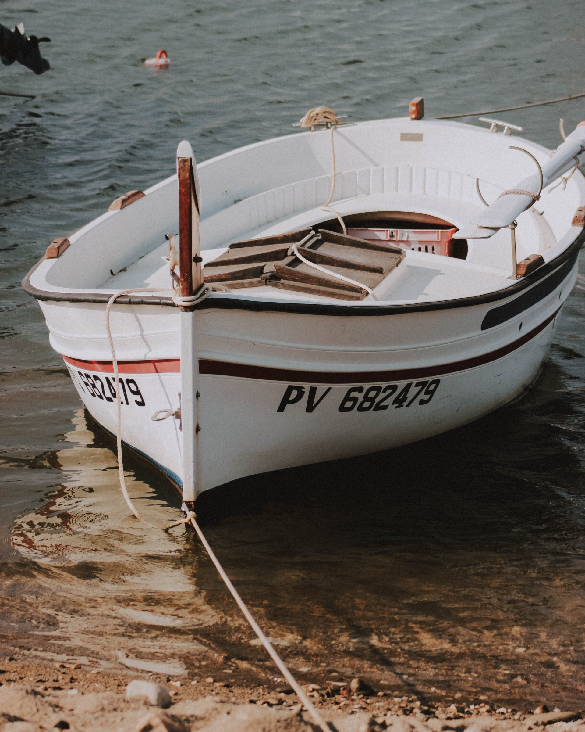 A dinghy boat securely tied up