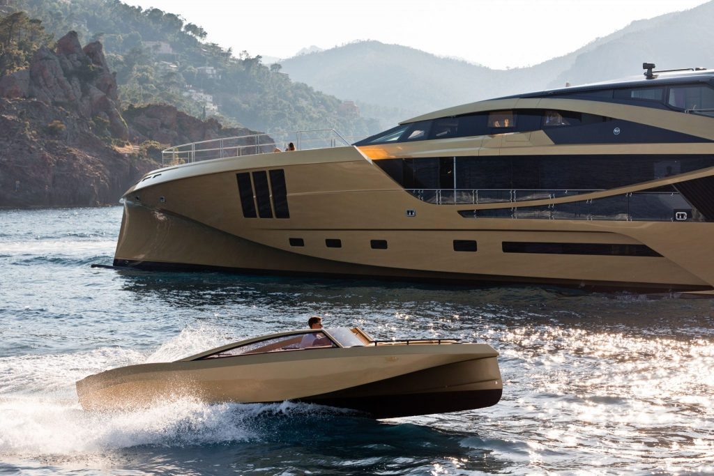 Custom 7m gold tender cruising through the water