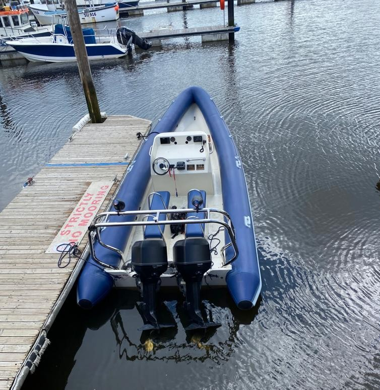 Rob's custom made RIB tied onto the pontoon at the Solent.