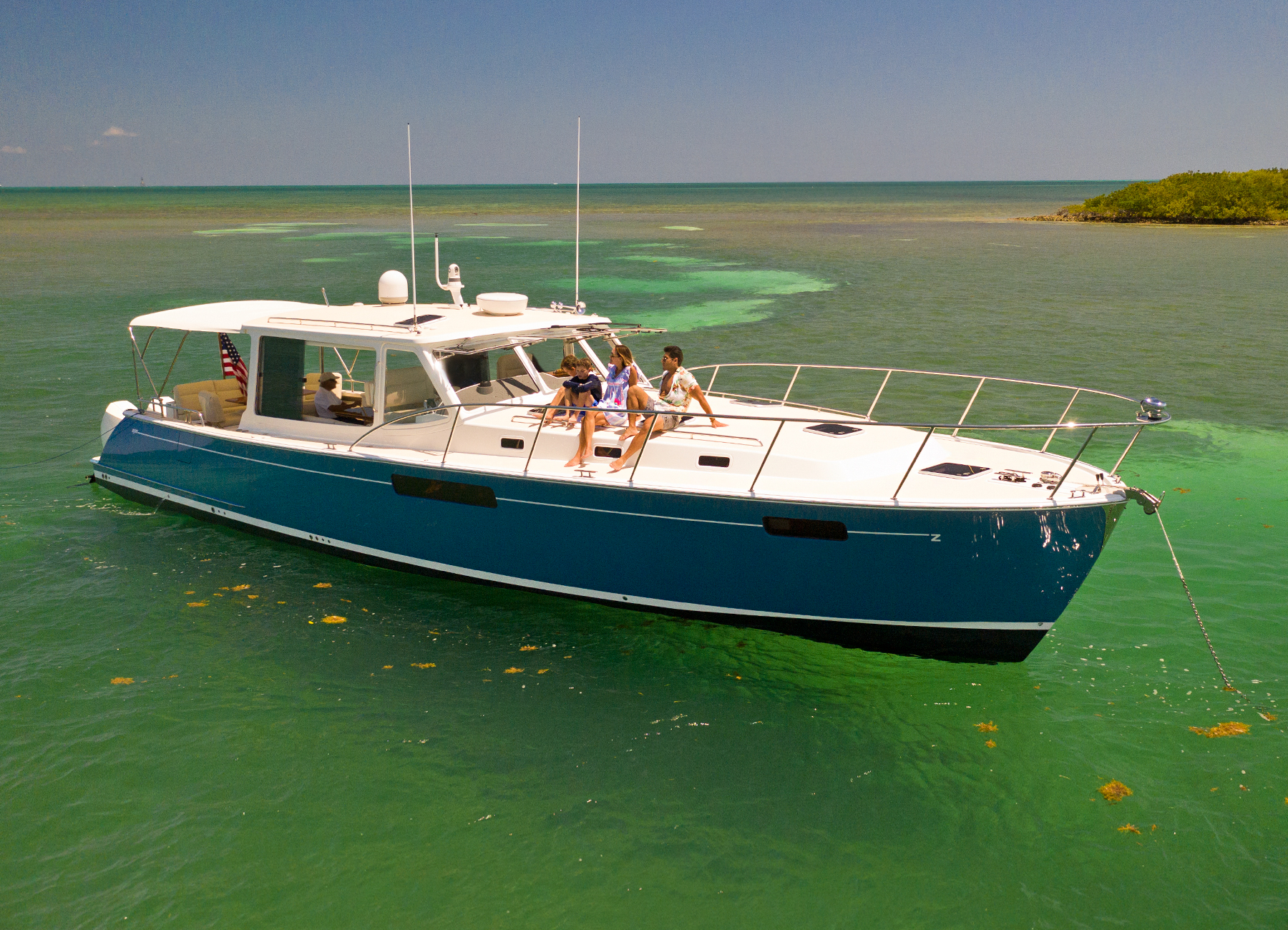 MJM Yachts 53z Outboard Express Cruiser In Shallow Water by island